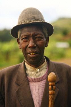 RW1144AW Gisenyi, Rwanda. A local elderly man walks to the market in Gisenyi.