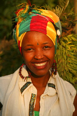 RW1156AW Kigali, Rwanda. An Ethiopian woman is photographed in her garden.
