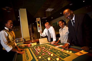 RW1176AW Kigali, Rwanda. Gamblers try thier luck at kigalis Top Tower casino. (MR).