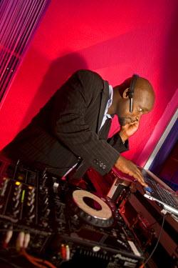 RW1177AW Kigali, Rwanda. A DJ entertains at a local nightclub. (MR).