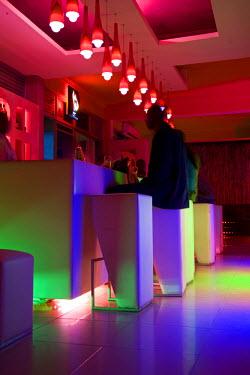 RW1178AW Kigali, Rwanda. Rwandans enjoy a beer at a new local nightclub.