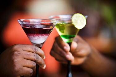 RW1182AW Kigali, Rwanda. Customers enjoy cocktails in a new restaurant. (MR).