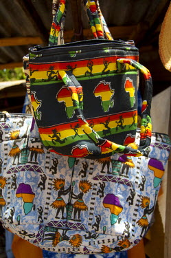 AF18_CMI0039 Africa, Gambia. Capital city of Banjul. Banjul Craft Market. Colourful textile handbags.