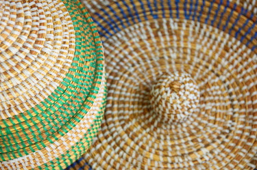 AF18_CMI0041 Africa, Gambia. Capital city of Banjul. Albert Market & Banjul Craft Market, colourful hand made baskets.