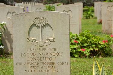 AF18_CMI0075 Africa, Gambia. Capital city of Banjul. Fajara War Memorial. WWII African Pioneer Corps markers, 1942.