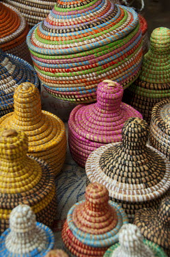 AF18_CMI0092 Africa, Gambia. Capital city of Banjul. Colorful hand made straw baskets.