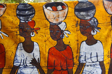AF18_CMI0095 Africa, Gambia. Capital city of Banjul. Local batik workshop, colourful hand painted textiles depicting every day African life & attire.