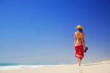 AUS1542AW Woman walking on Floreat beach, Perth, Western Australia, Australia (MR)