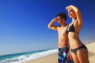 AUS1546AW Couple standing on Floreat beach, Perth, Western Australia, Australia (MR)