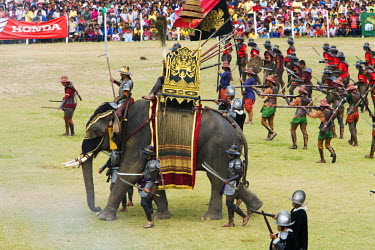 THA0249 Thailand, Surin, Surin.  Ancient war re-enactment in Srinarong Stadium during the Elephant Roundup festival.  The event held in November sees hundreds of elephants involved in a celebration of the reg...