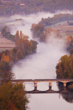 FR06355 France, Aquitaine Region, Dordogne Department, Domme of the Dordogne River Valley in fog from the Belvedere de la Barre