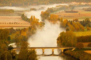 FR06356 France, Aquitaine Region, Dordogne Department, Domme of the Dordogne River Valley in fog from the Belvedere de la Barre