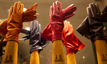 IT9375 Venice, Veneto, Italy; Colourful designer leather gloves on display in a shop window