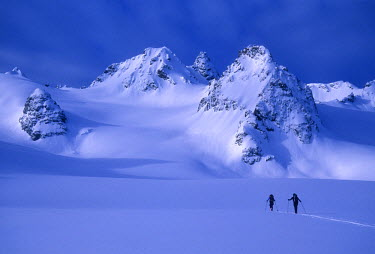 AR8876300039 Two skiers ski tour and explore the Lyngen Alps of Norway