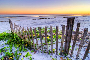 AR4159900011 A beach fence at sunset on Hilton Head Island, South Carolina, USA