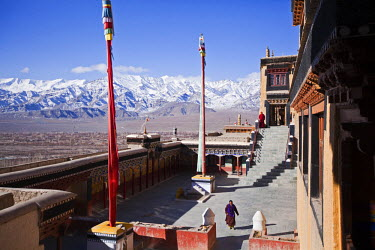 IND6583 India, Ladakh, Thiksey. The open courtyard of Thiksey Monastery, and view towards the Zanskar Range.