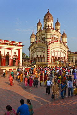 IND6383 The Dakshineswar Kali Temple on the outskirts north of Kolkata was founded in 1855 by Rani Rashmani. The beautiful red and yellow building is thronged by devotees every day of the week.