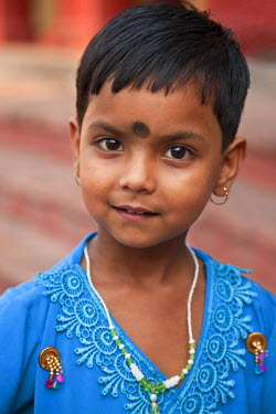 IND6434 A young devotee at the Dakshineswar Kali Temple on the outskirts of Kolkata. The temple was founded in 1855 by Rani Rashmani.