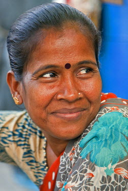 IND6435 A happy woman at the Dakshineswar Kali Temple on the outskirts of Kolkata. The temple was founded in 1855 by Rani Rashmani.