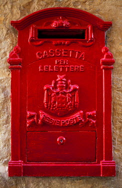 MLT0215 Malta, Europe; A coloured letter box, normally found in village or town cores complimenting colourful doors and windows