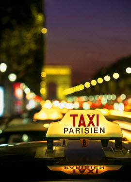 On top of a Taxi in Paris, France