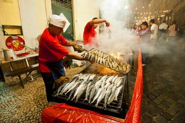 POR6540AW Grilled sardines at the Santo Antonio festivities in Alfama quarter. Lisbon, Portugal