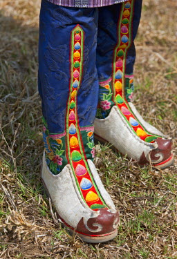 BHU1526 Tsholham - traditional knee-length boots that are worn by Bhutanese men during important ceremonial occasions. They are commonly hand-stitched from cow or sheep hide and decorated with brocade and emb...