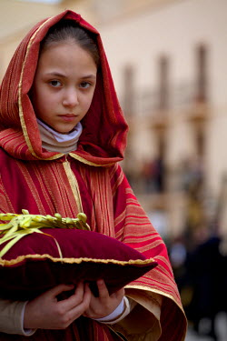 IT9420 Sicily, Italy, Western Europe; A girl in costume during the 'Processione dei Misteri' of Trapani