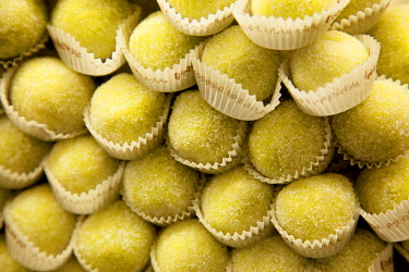 IT9568 Sicily, Italy, Western Europe; 'Bocconcini'- small delicacies made up of almonds and lemon filling with a 'marzipan' cover at Maria Grammatico's 'Pasticceria del Convento' confectionery shop in Erice