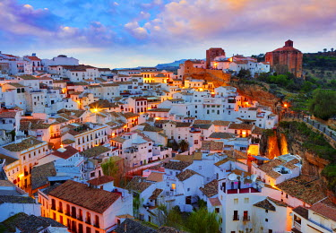 SPA3856AW Spain, Andalucia, Setenil, view over village at dusk