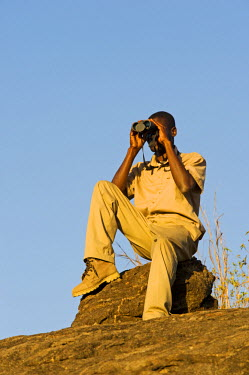 MW1248 Malawi, Majete Wildlife Reserve. A guide with Robin Pope Safaris out on a bush walk.