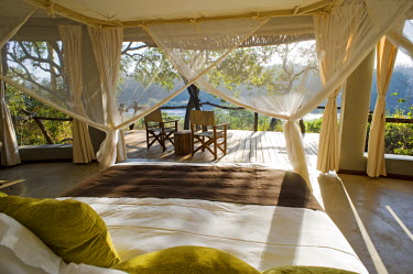 MW1263 Malawi, Majete Wildlife Reserve. Bedroom at  Mkulumadzi luxury safari lodge on the edge of the Shire River.