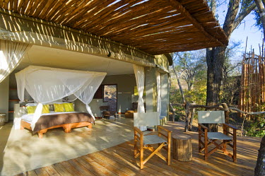 MW1265 Malawi, Majete Wildlife Reserve. Bedroom at  Mkulumadzi luxury safari lodge on the edge of the Shire River.