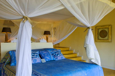 MW1409 Malawi, Lake Malawi National Park.  Luxurious bedroom of one of the chalets at Pumulani Lodge.