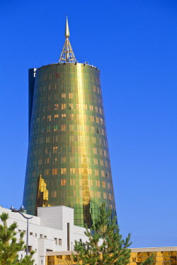 Kazakhstan, Astana, Twin golden-green, conical business centre