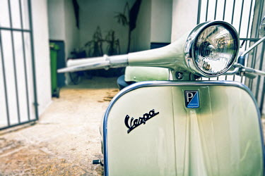IT9730AW Italy, Puglia, Lecce district, Salentine Peninsula, Salento, Gallipoli, detail of a Vespa Scooter in a  courtyard.