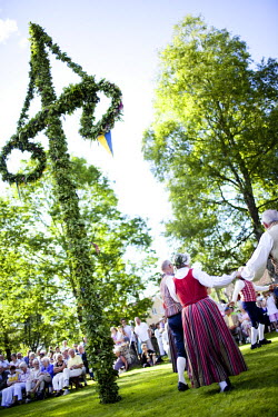 NP07140496 People celebrating midsummer in a traditional festival, Sweden.