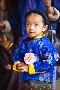 Young girl at the National Memorial Chorten, which was built in the Tibetan style in 1974 to honour the third king of Bhutan.