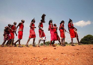 KEN7668 Maasai warriors perform a welcome dance at a lodge in the Masai Mara, Kenya.