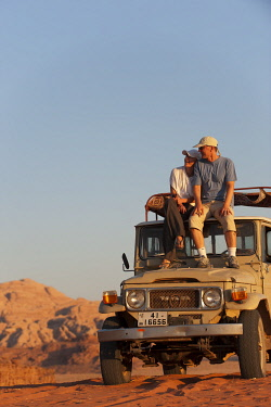 JOR0285 Couple on Jeep in the Wadi Rum, Jordan