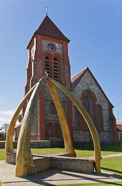 FAL0657 The large brick and stone Christ Church Cathedral was built between 1890 and 1892.  The whalebone arch, made from the jawbones of two blue whales, was erected in 1933 to commemorate a centenary of Bri...