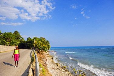 HAT0005 The Caribbean, Haiti, Port of Prince, Jacmel, women walking near a beach,