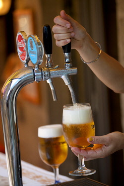 ITA1013 Europe, San Marino. Draught beer poured in a glass