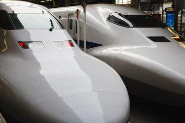 JAP0375AW Japan, Kanto Region, Tokyo. Two Shinkansen Bullet Trains wait to depart from Tokyo station.