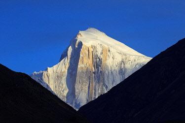 PAK0129AW Pakistan, Gilgit-Baltistan, Hunza Valley, Karimabad. Golden Peak, also known as Spantik, seen at sunset.