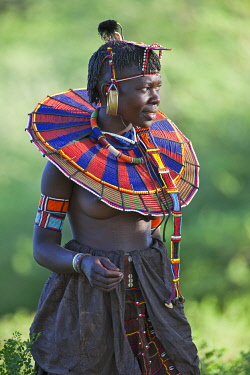 A Pokot woman in traditional dress. Her leather skirt is made from tanned goatskins.