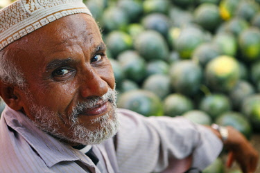 YEM0234AW Yemen, Al Hudaydah, Bait Al Faqhi. A man sells watermelons at the Friday market.