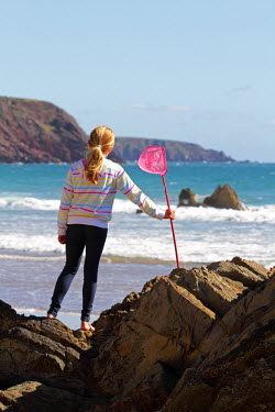 WAL7373 Girl with shrimping net at Marloes Sands, Pembrokeshire, Wales. MR