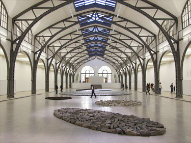 EU10_MME0000_M 'Berlin Circle' by Richard Long at the Hamburger Bahnhof Museum. Ellipse of Stones in the foreground.  Germany, Berlin