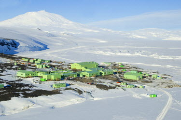 Antarctica, Ross Island. The New Zeland Scott base research station with Mount Erebus in the backtround. Aerial view.
